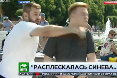 Russian Reporter Punched In Face By Drunken Man During Live Report