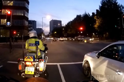 Driver Jumps Red Light Right Next To Police Officer On A Bike, Recives Instant Karma
