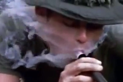 Soldiers Getting High With Marijuana From A Shotgun In Vietnam