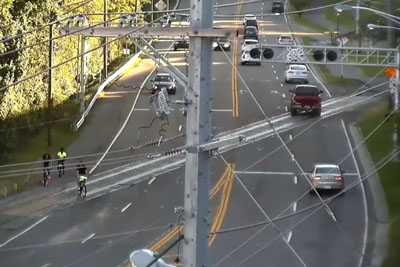 Security Camera Captures Bicycle Crashes At Skewed Rail Crossing One After Another