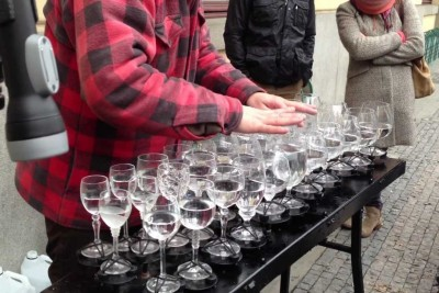 Man Places Glasses On Table. When He Starts To Play On Them, Everyone Is Speechless