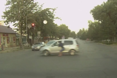 Woman Hangs Onto Taxi Driver Window In Kyrgyzstan