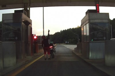 Motorcycle Rider Has Tough Time At Toll Booth