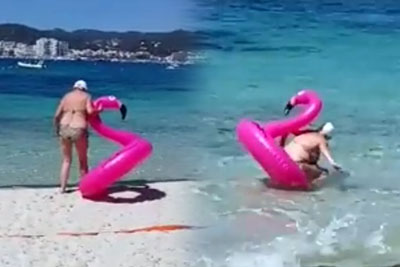 Grandma Steals The Whole Show On A Inflatable Flamingo On The Beach In Spain
