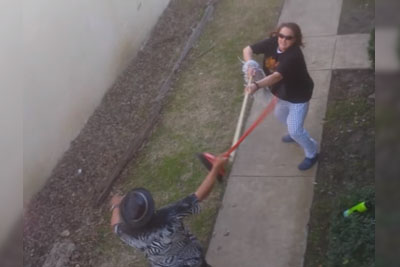 Two Crackhead Neighbors Fight Each Other With Brooms In Hands