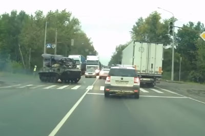 Tank In Russia Drifts And Spins Out At Intersection, Hits Car