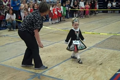 Tiny Girl Nervously Walks Onstage, Then Her Quick Stepping Moves Have Crowd Instantly Cheering