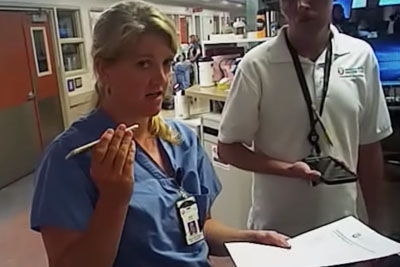 Nurse Legally Prevents Cop From Taking Blood From Unconscious Patient, Gets Roughly Arrested