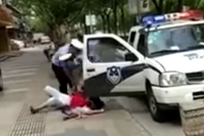 VIDEO: Chinese Police Officer Body Slams A Woman Holding Her Baby To The Ground