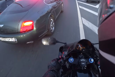 Bentley Driving Douche Gets Instant Karma From A Biker After Littering