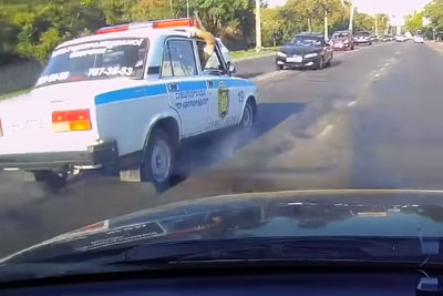 Stupid Driver Overtakes Over Solid Line, Crashes Into A Police Car Head On