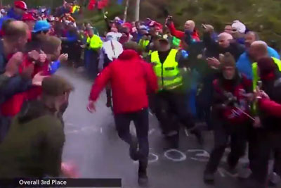 Fan Chases After Cyclist, Gets Obliterated By Cops