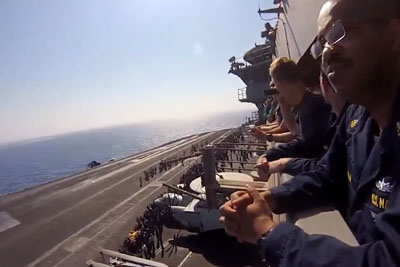 US Navy Jet Breaks Speed Of Sound Flying Past Aircraft Carrier
