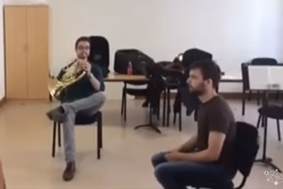 He Was Sitting On A Chair Playing French Horn, Then His Friend Stole Whole Attention