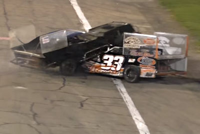 Racer Drives Over Top Of Another Car, Police Arrest Second Driver